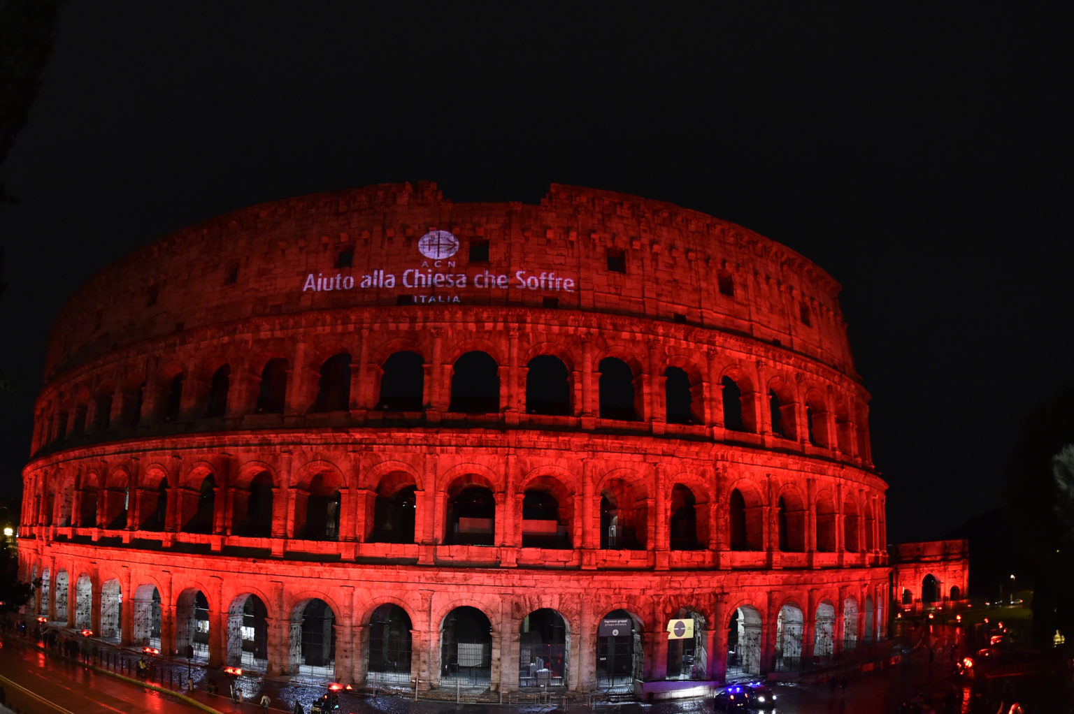 Italy, Rome 24th of February 2018 ACN Event - Illuminated Coliseum in Red - with ACN Logo